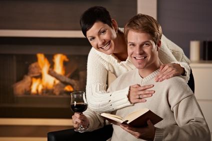 Couple enjoying wine and book